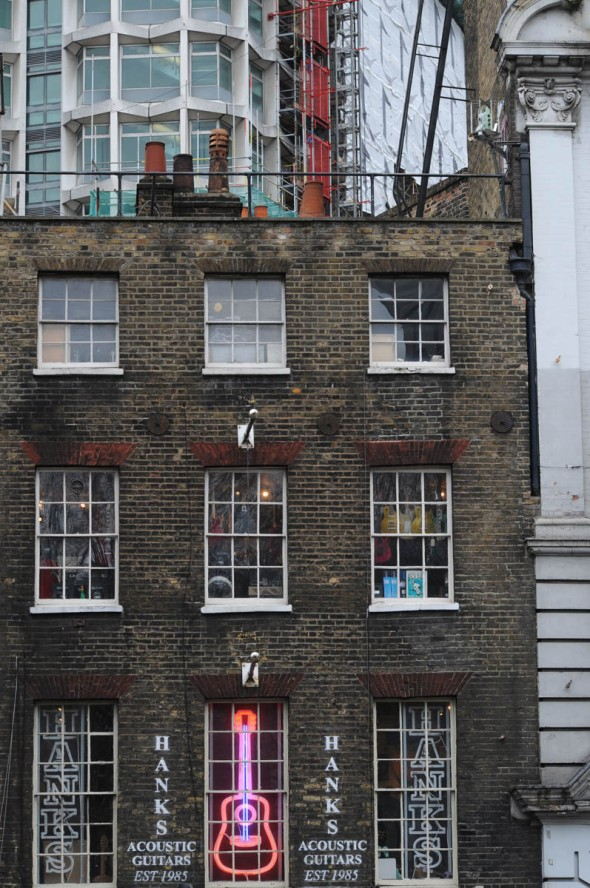 Hank's Guitars, with Centre Point tower block behind, Denmark St