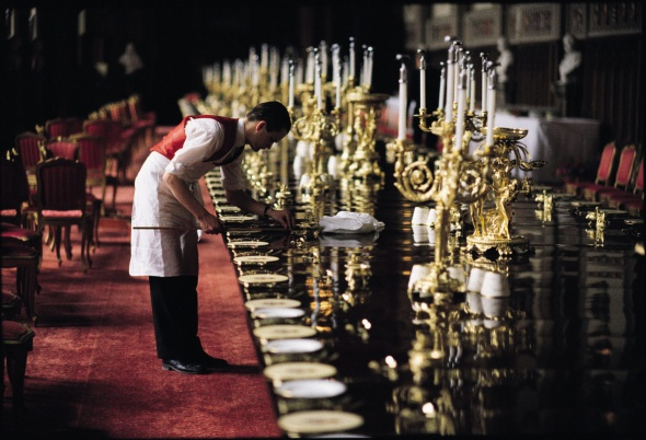Footman laying places for 200 guests prior to a state banquet in honour of Polish premier Lech Walesa, St George's Hall, Windsor Castle, May 1991